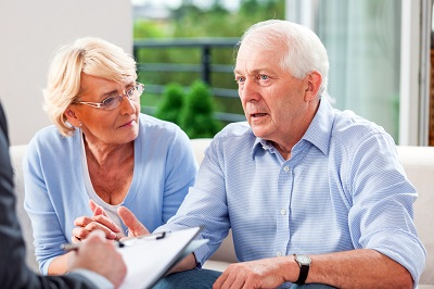 image of couple discussing Medicare options with insurance agent